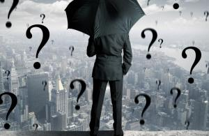 businessman surrounded with question marks